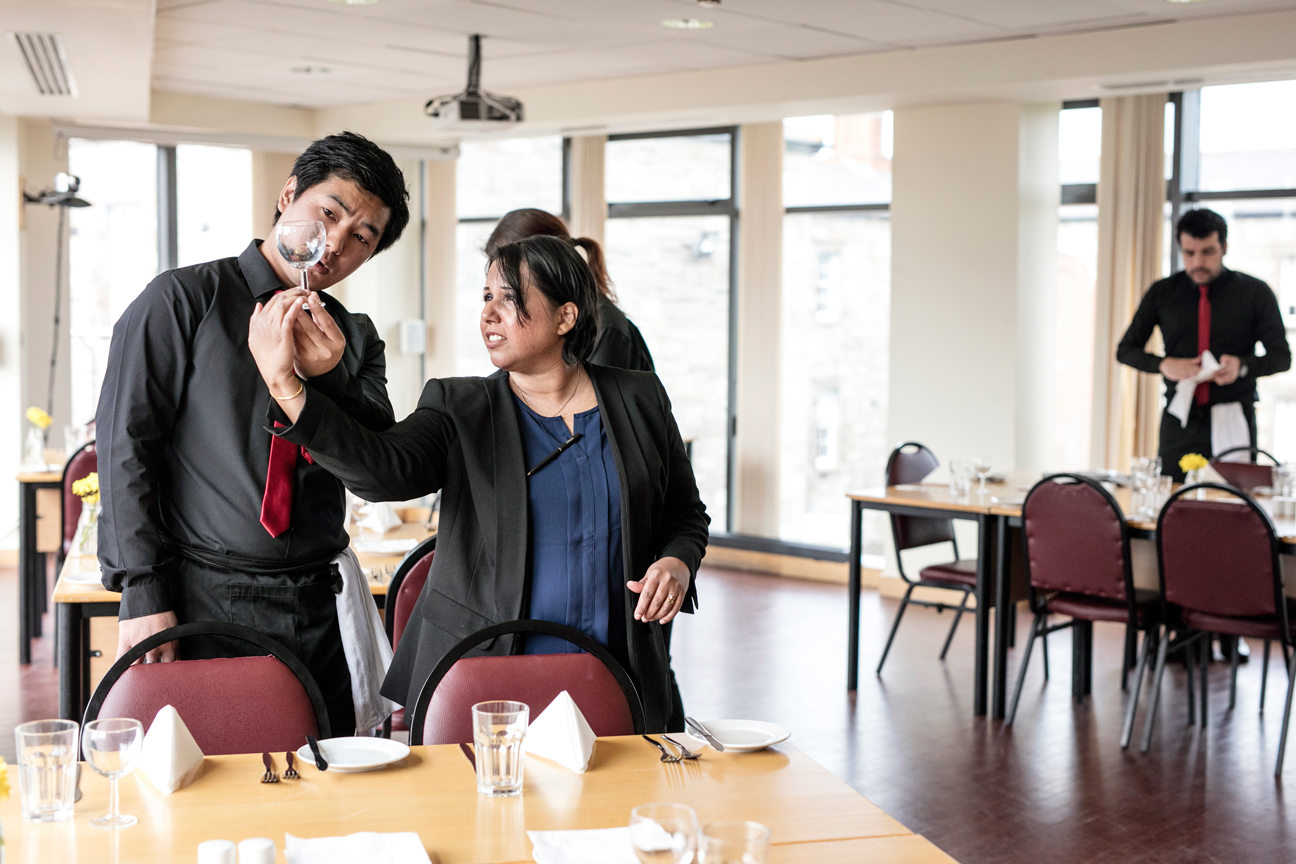 Hospitality students setting up the student-run restaurant