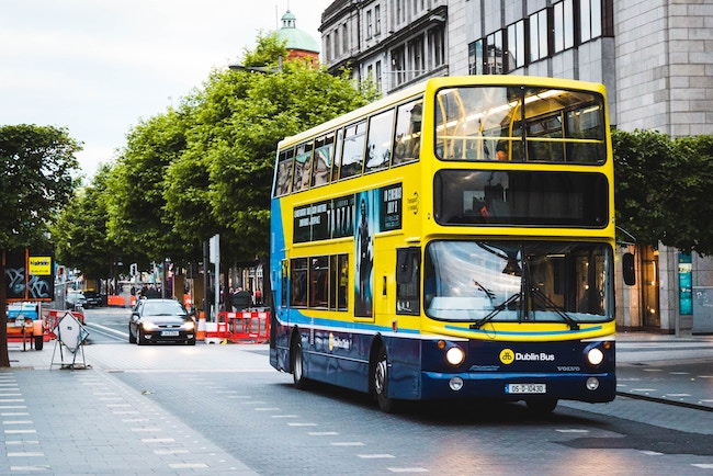 A Dublin bus traveling through the city