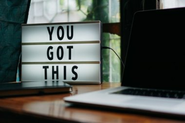 "A desk lamp spelling out ""You got this"""