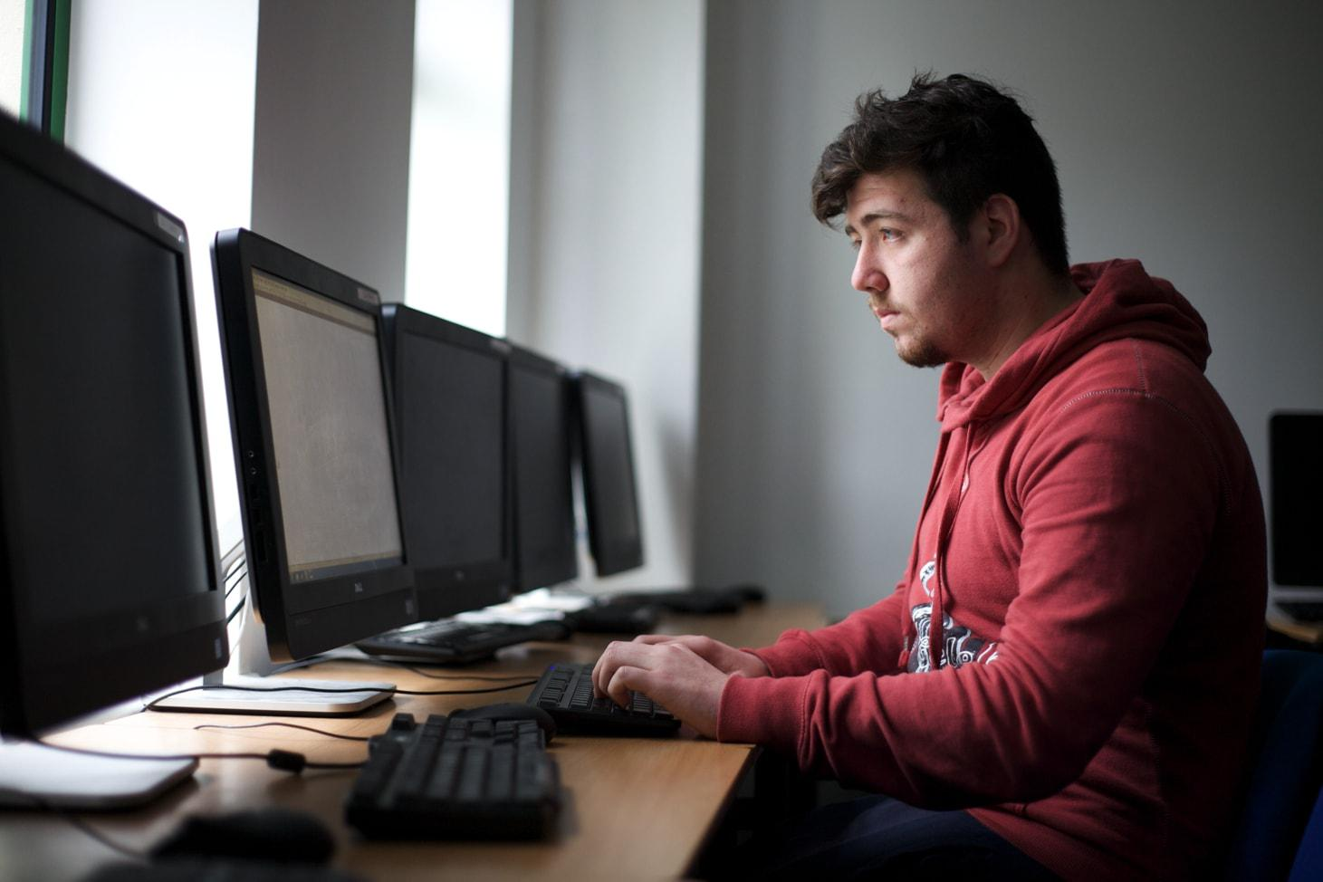 Student working in lab in Computing