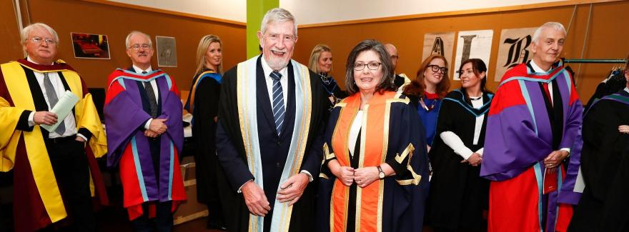 Chair of the Policing Authority Josephine Feehily accepting the Distinguished Fellowship Award from the President of Griffith College Professor Diarmuid Hegarty