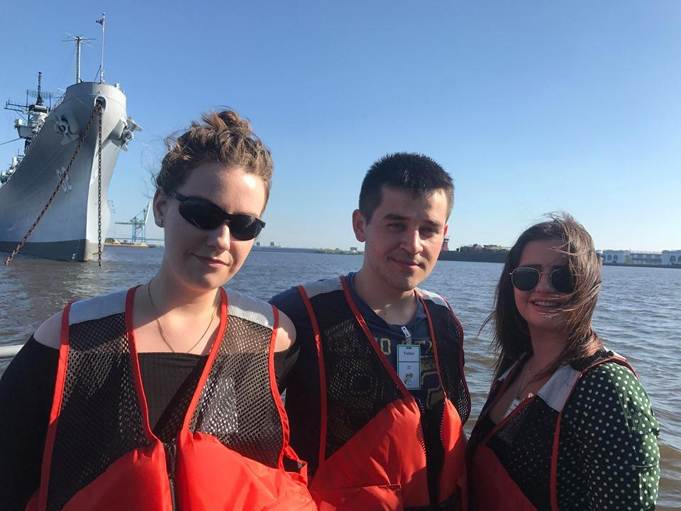 Cora, Tom and Catherina in front of battleship