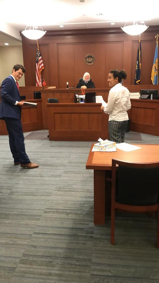 American intern Noah and Griffith intern Asma in court