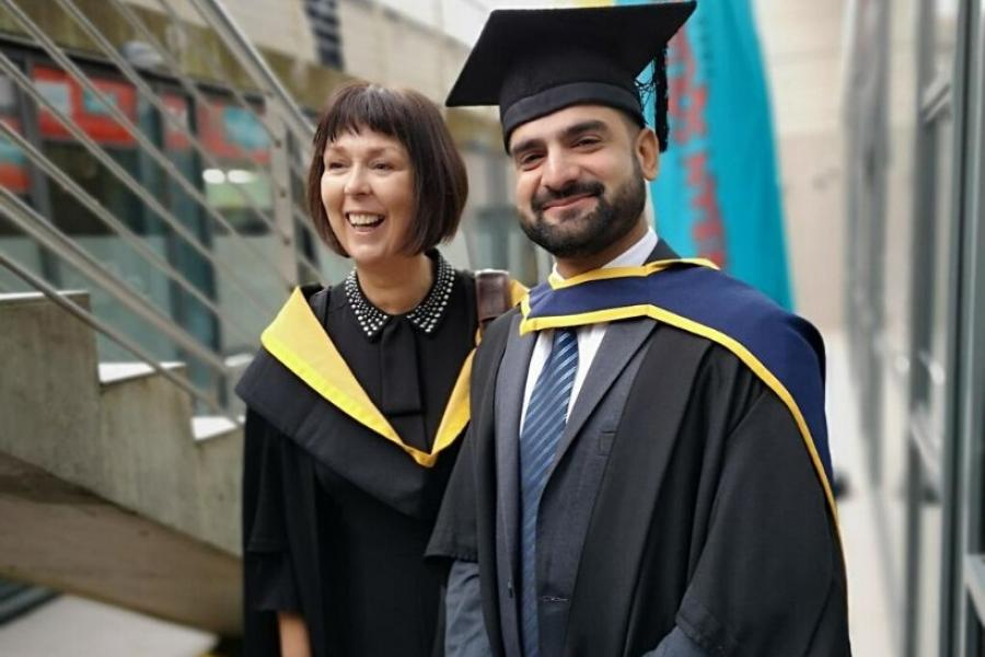 Accountancy lecturer Paula Byrne with a graduating student
