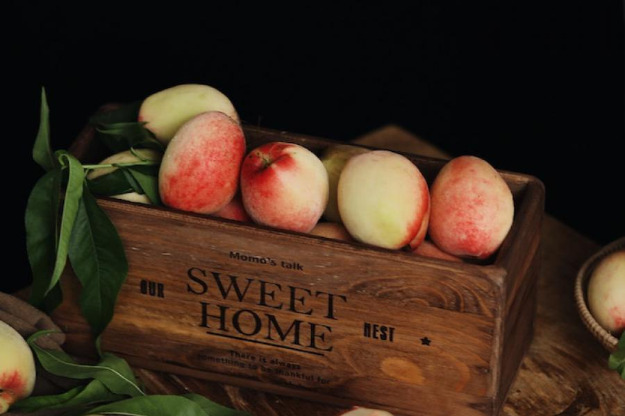 A box of fruit against a dark background