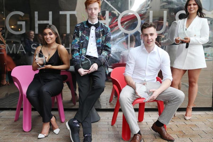 Griffith College film students posing with their awards outside the Lighthouse Cinema, Dublin