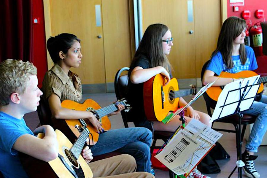 A group of LSMD guitar students in a lesson