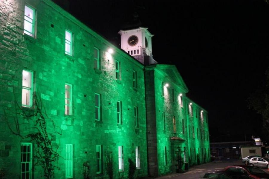 Griffith College's main building lit up green for Culture Night 2019
