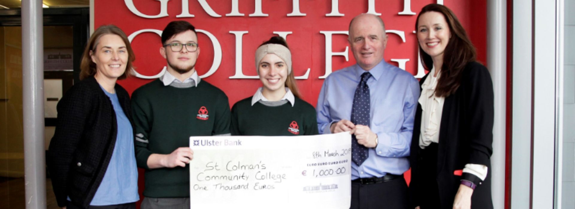 Presentation of a bursary cheque to one of the winning schools