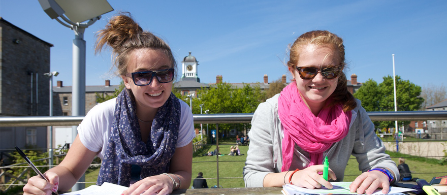 Students Enjoy the Sun While Studying