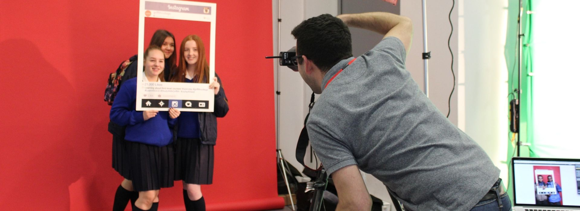 Students visit a Griffith College open day and pose with an Instagram frame while their photo is taken