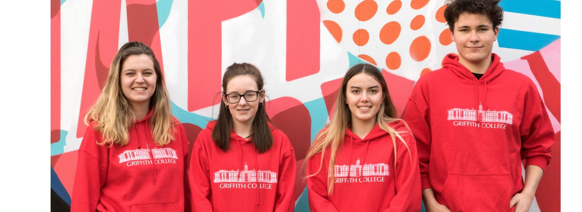 Scholarship students wearing Griffith College jumpers on the Dublin campus