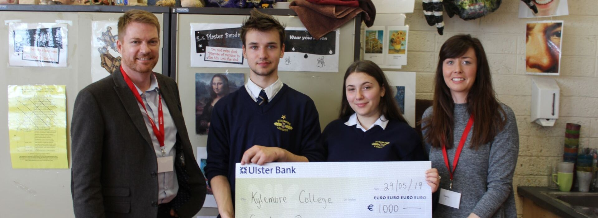 Griffith College Schools Liaison Officer presents a bursary check to students at Kylemore College
