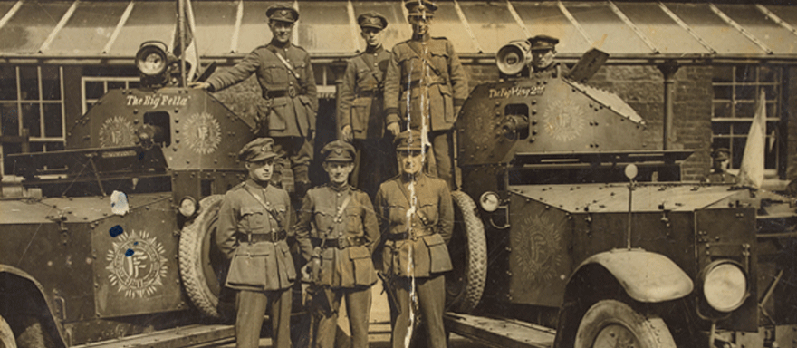 Free State officers in front of armoured cars. Centre in the front row is Tom Ennis, who commanded the National Army takeover of Wellington Barracks. (Courtesy of the National Library of Ireland)