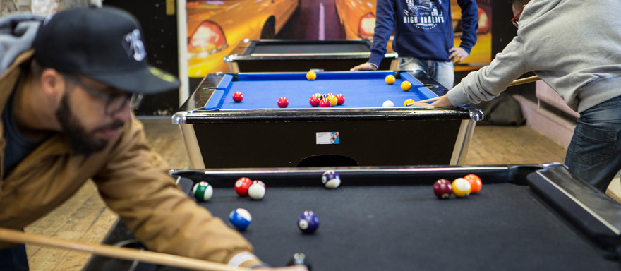 Students playing pool in the SU