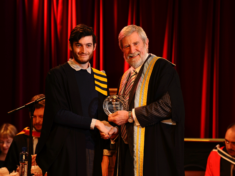 Diarmuid Hegarty Hands parchment to student