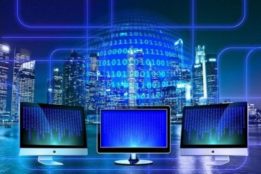 Three computers depicting digital transformation