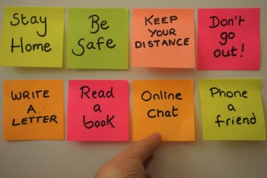 "Sticky notes with reminders for the COVID-19 world like ""be safe"" and ""stay home"""