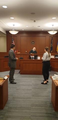 Tom and Sarah in the courtroom