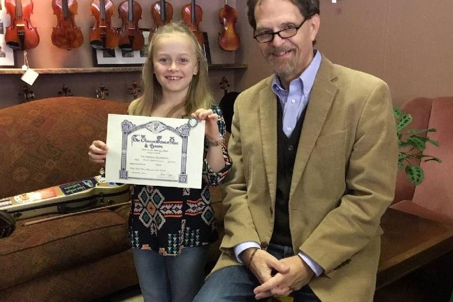 ten year old Abi Snell is accompanied by Griffith College lecturer, Tom Morley Photo Credit: Chattanooga Times Free Press