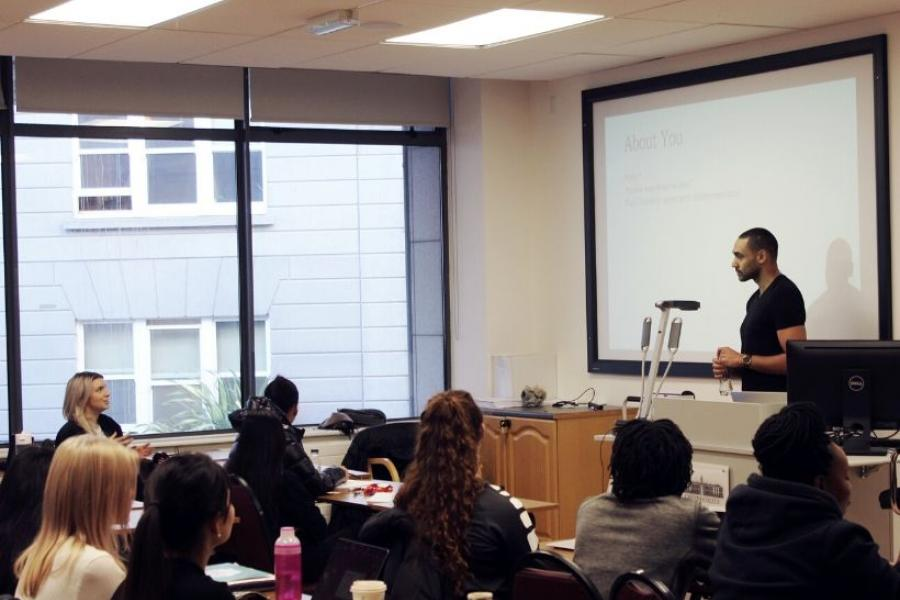 Guest lecturer Kareem Mostafa presents to the Graduate Business School students