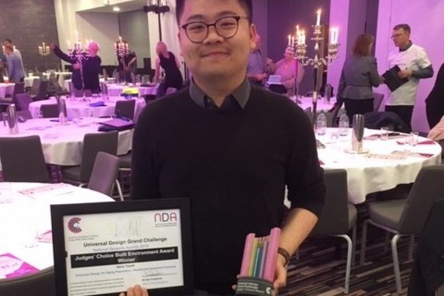 Griffith student Gerry Triyadi poses with his trophy and certificate at the Universal Design Awards