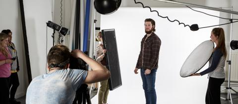 Students doing a shoot in the photography studio