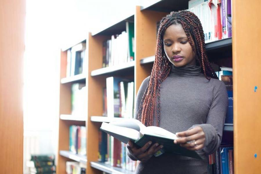 Student in Law Section of Library