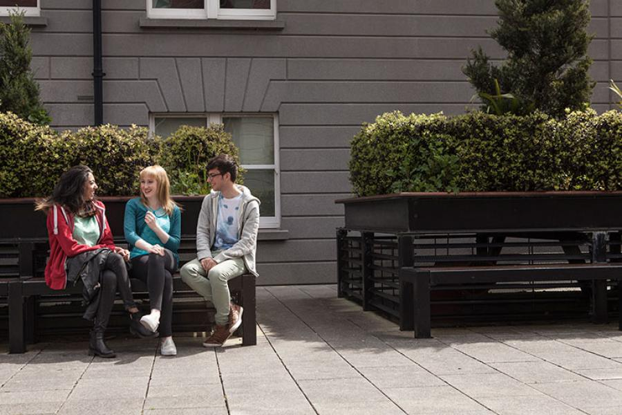 Students chatting on benches around Griffith College Dublin