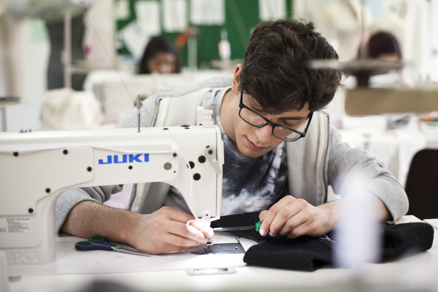 Fashion Design student working in our industry standard sewing room.jpg
